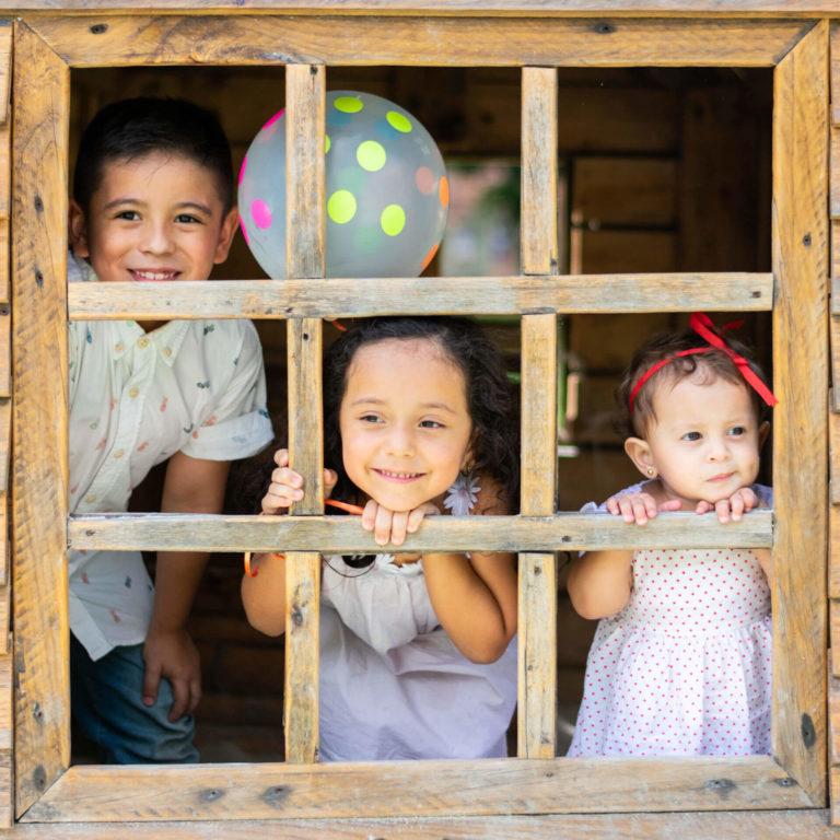 Kids standing in window